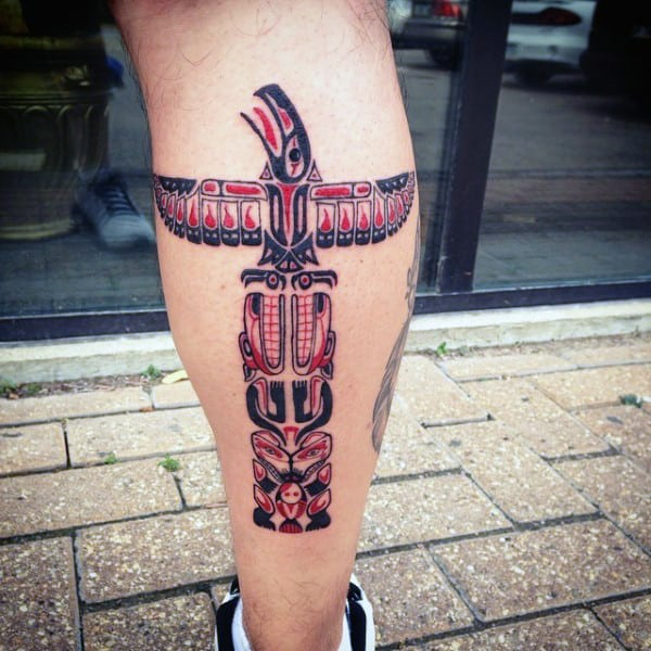 Man With Hieroglyphic Totem Pole Calf Tattoo