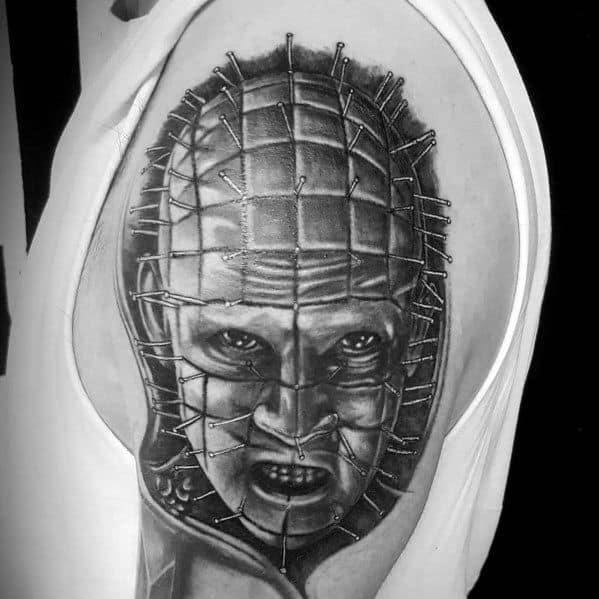 Man With Horror Movie Tattoo Design Hellraiser Portrait On Arm