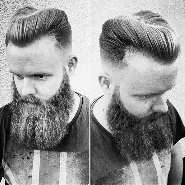 Man With Horseshoe Haircut Beard And Skin Fade Sides