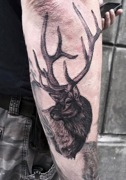 Man With Hunting Tattoo On Arm