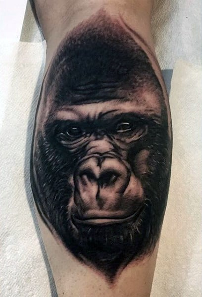 Man With Incredible Black Ink Gorilla On Back Of Leg Calf