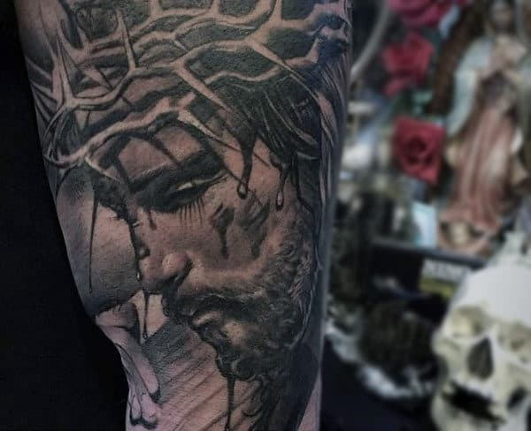 Man With Incredible Jesus Sleeve Tattoo