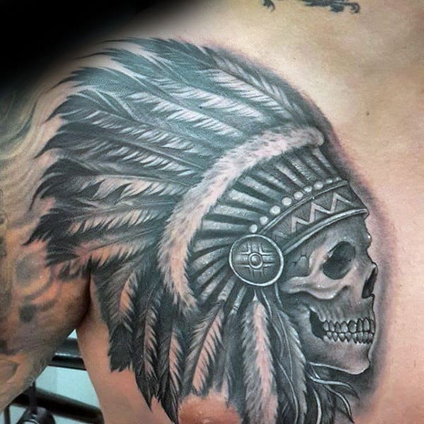 Man With Indian Skull Upper Chest Tattoo