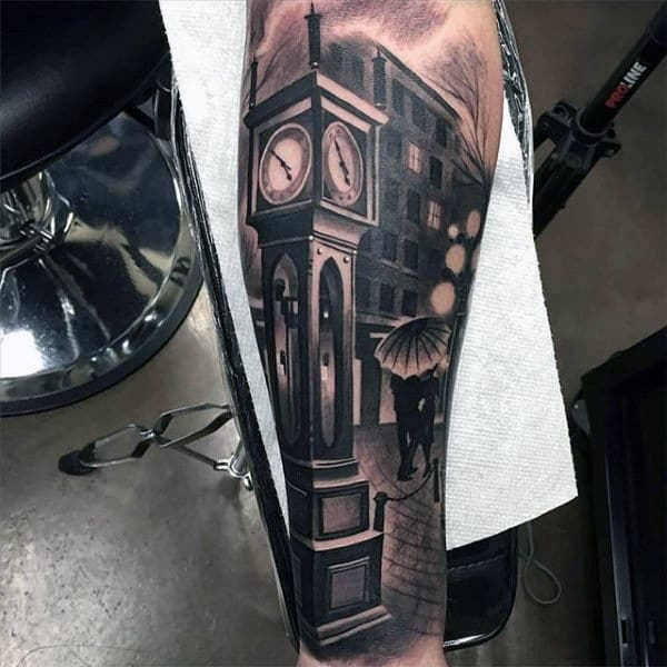 Man With Inner Arm City Street Clock Tower Tattoo