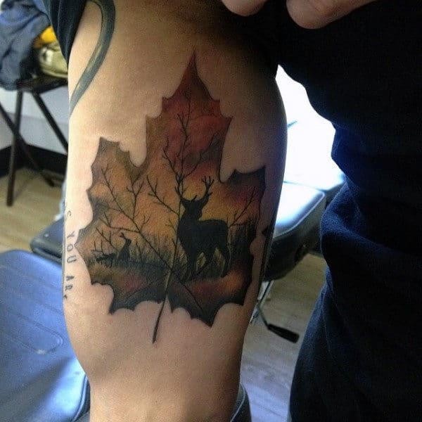 Man With Inner Arm Tattoo Of Leaf With Deer