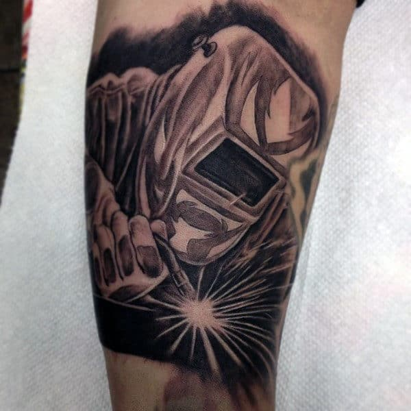 Man With Inner Arm Welder Tattoo