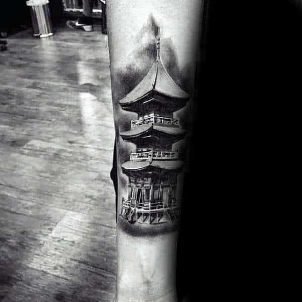Man With Inner Forearm Tattoo Of Japanese Temple
