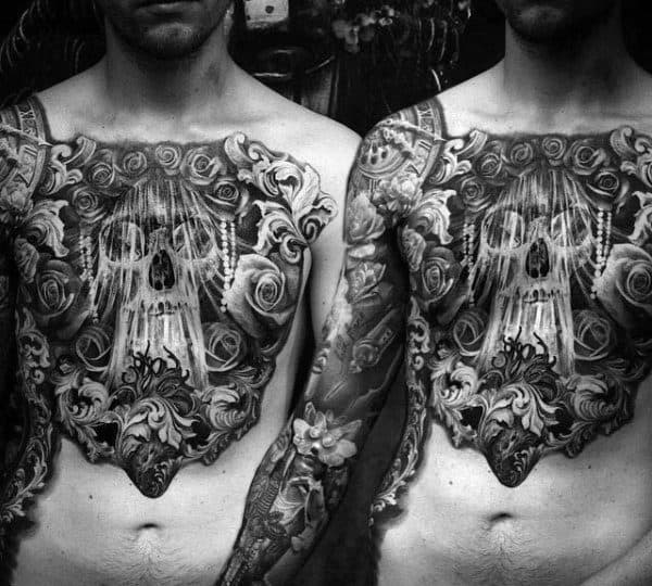 Man With Insane Black Ink Skull Chest Tattoos