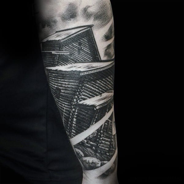 Man With Interesting Grey Blocks Tattoo Forearms