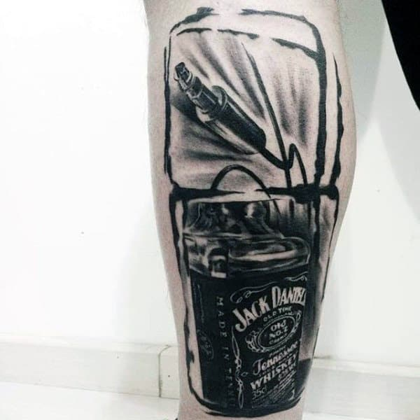 Man With Jack Daniels Watercolor Headphone Cord Tattoo On Leg