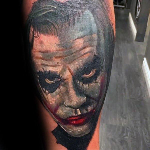 Man With Joker Face Tattoo On Arm