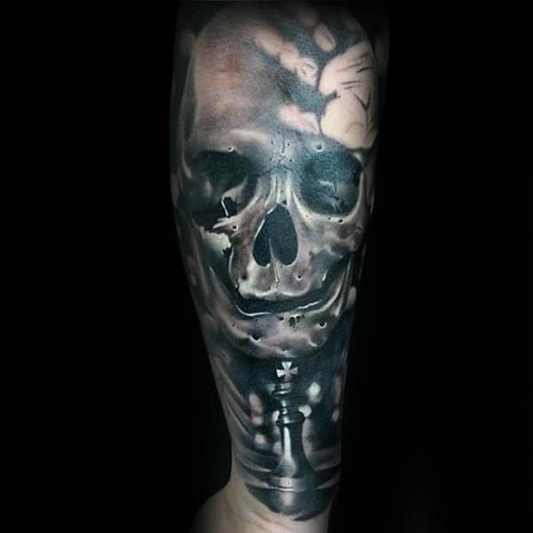 Man With King Chess Piece And Skull Forearm Sleeve Tattoo Design