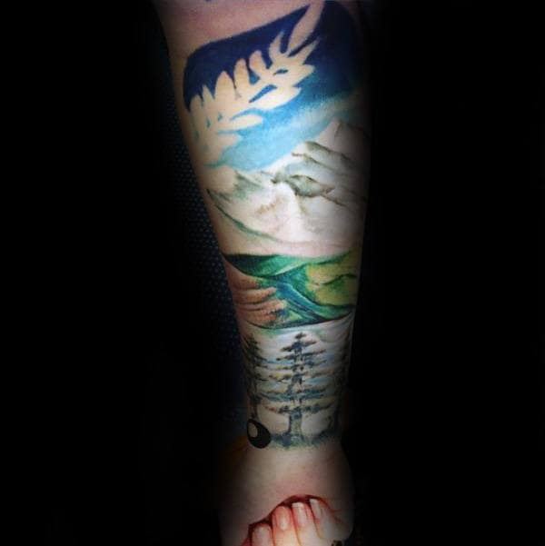 Man With Landscape Forearm Watercolor Sleeve Tattoo