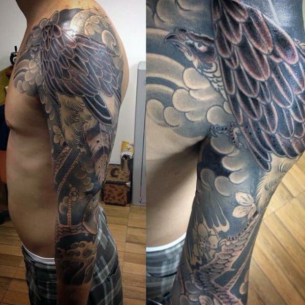 Man With Large Feathered Hawk Full Sleeve Tattoo