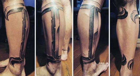Man With Large Gemini Leg Tattoo