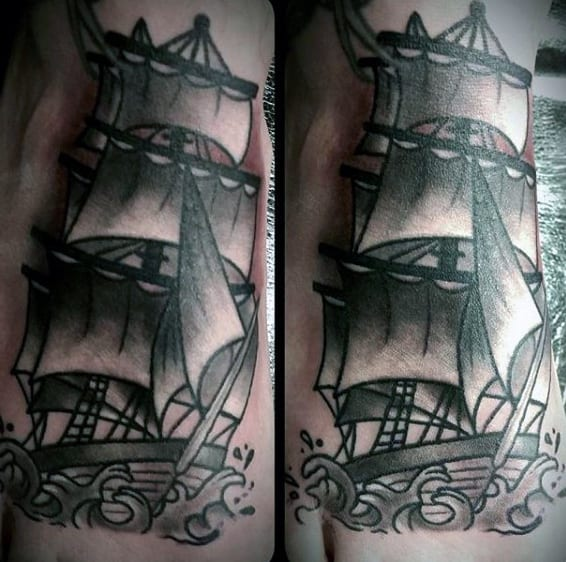 Man With Large Sailed Ship Tattoo On Foot