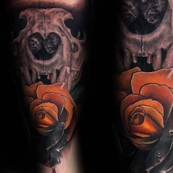 Man With Lion Skull Orange Rose Flower Forearm Tattoo