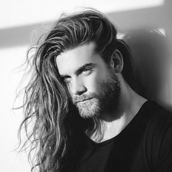 Man With Long Length Surfer Hair