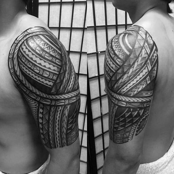 Man With Looped Half Sleeve Tribal Tattoo
