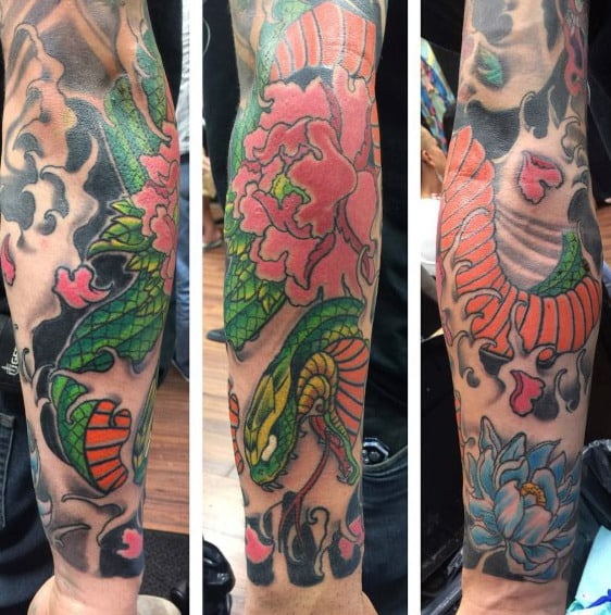 Man With Lotus Flower Snake Sleeve Tattoo