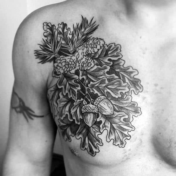 Man With Lovely Acorns And Oak Tree Leaves Tattoo On Chest