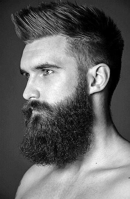 Man With Low Fade Faux Hawk Hairstyle And Beard