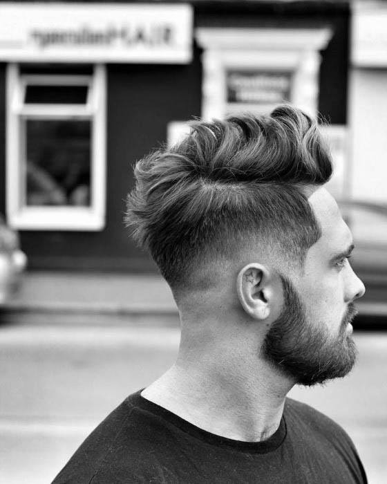 Man With Low Fade Haircut With Beard