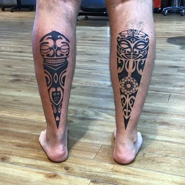 Man With Maori Tattoos On Back Of Legs