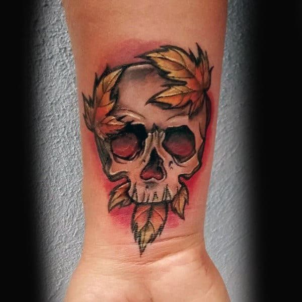 Man With Maple Leaf Skull Tattoo On Wrist