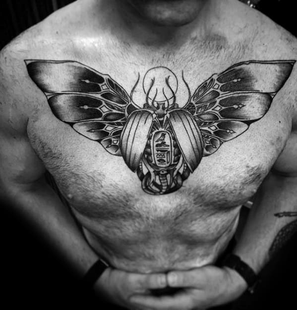 man with masculine scarab bettle tattoo design on chest