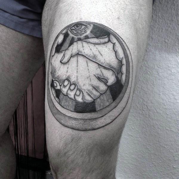 Man With Masonic Handshake Tattoo On Upper Thigh Of Legs