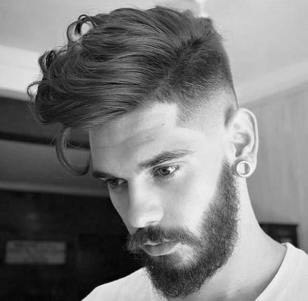 Man With Medium Hair Style Wavy And Beard