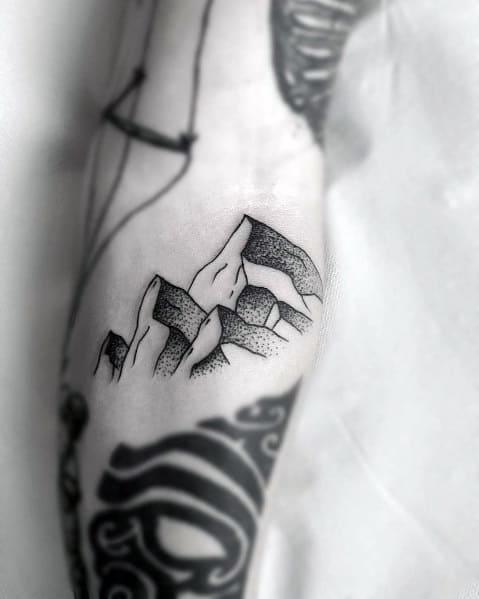 Man With Minimalist Mountain Tattoo Design