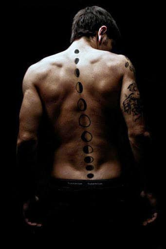 Man With Moon Phases Spine Tattoo