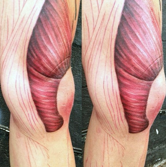 Man With Muscle Thigh Tattoo