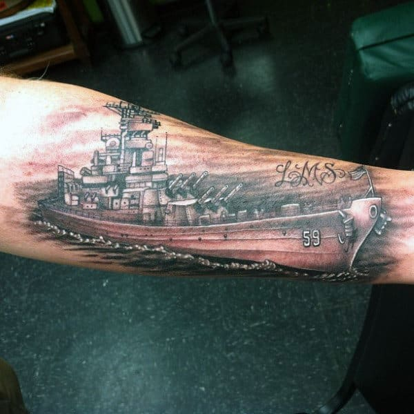 Man With Navy Ship Forearm Tattoos