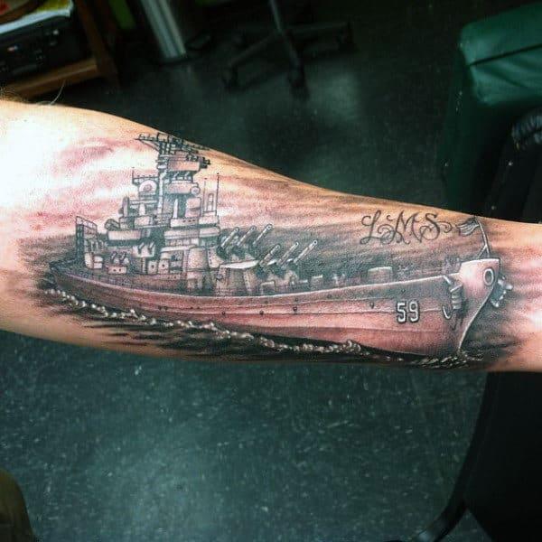 Man With Navy Ship Forearm Tattoos