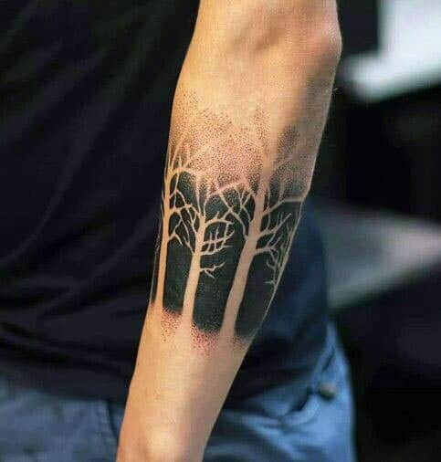 Man With Negative Space Black Ink Tree Forest Tattoos On Outer Forearm