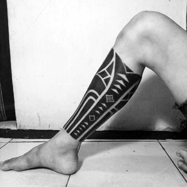 Man With Negative Space Shapes Leg Sleeve All Black Ink Tattoo