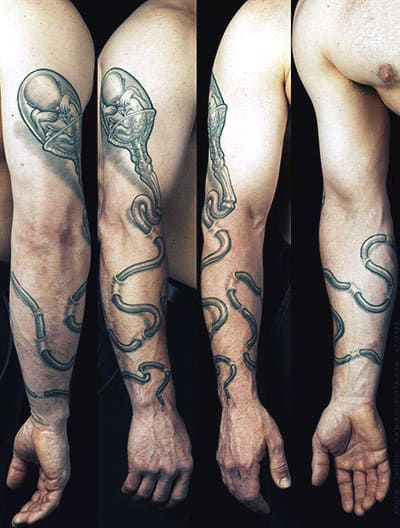 Man With Nerdy Tattoos On Arm