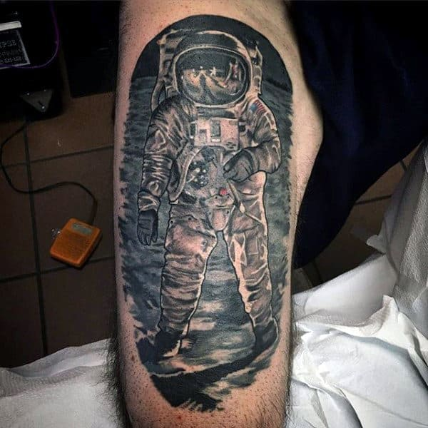 Man With Noble Astronaut Tattoo On Arms