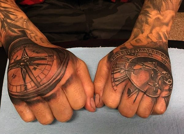 Man With Nordic Compass Tattoo On His Hands