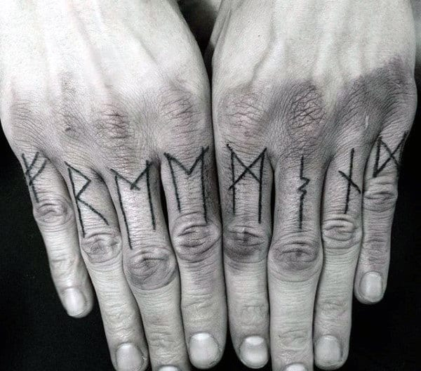 Man With Norse Rune Knuckle Tattoos