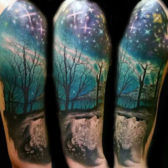 Man With Northern Lights Sleeve Tattoo