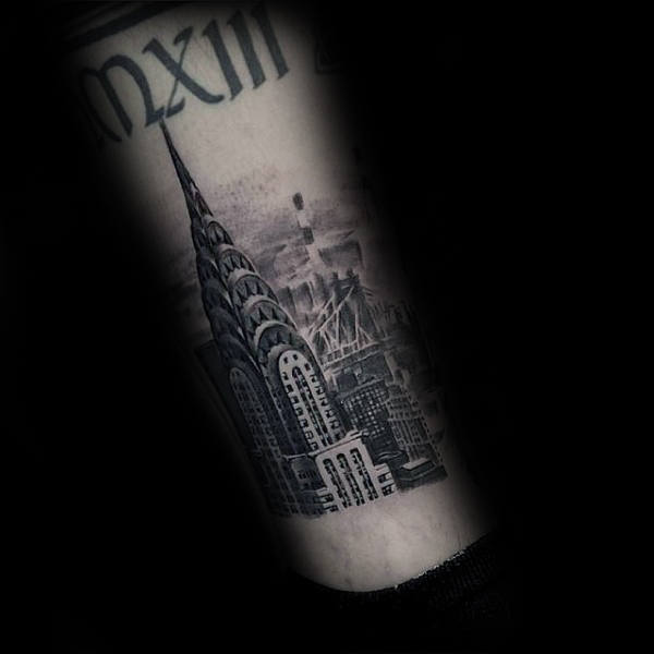 Man With Nyc Building Tattoo On Lower Leg