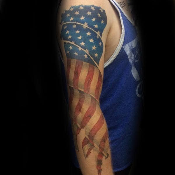 Man With Patriotic Full Arm Tattoo Of Waving Us Flag Design
