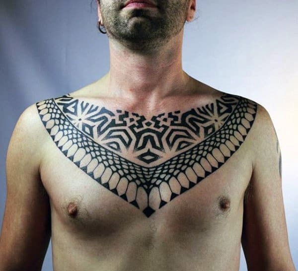 Man With Pattern Tattoo On Chest