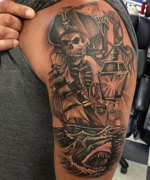 Man With Pirate Life Tattoo On Arm