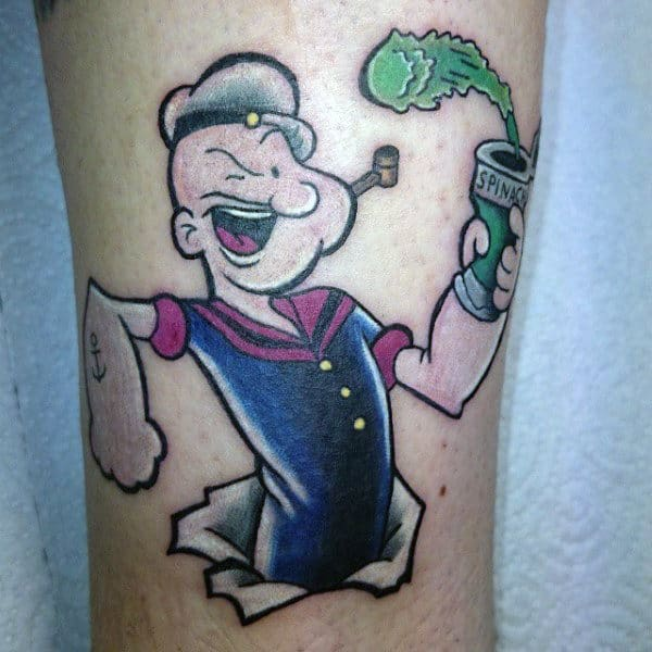 Man With Popeye Spinach Arm Tattoo
