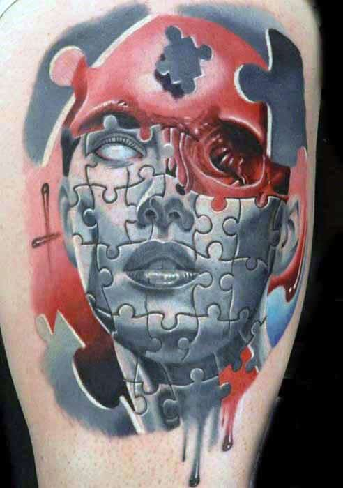 Man With Portrait Red Ink Puzzle Thigh Tattoo